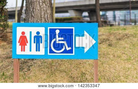 Disability Toilet wooden signage in japanese park.