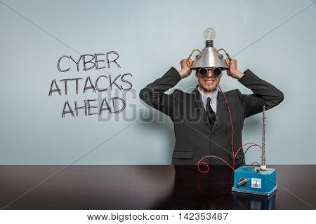 Cyber Attacks Ahead text with vintage businessman and machine at office