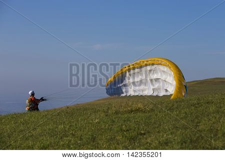 PIANI DI RAGNOLO, ITALY - AUGUST 09  2016: Paragliding in the national park of the Sibillini Mountains in Italy.