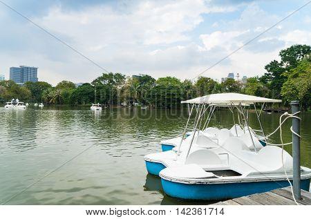 Pedal Boats pier in Bangkok park lake