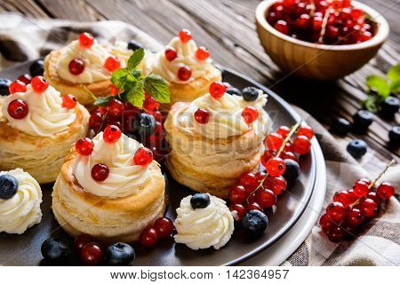 Puff Pastry Cakes Filled With Whipped Cream And Berries