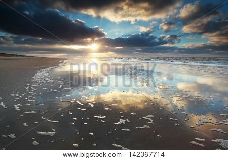 sunshine over North sea beach Zandvoort Netherlands