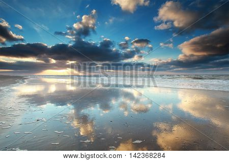 sky reflection in North sea water Holland