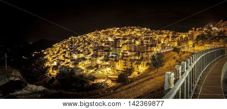 Nocturnal panoramic view of Prizzi a typical village located in the middle of the Sicily