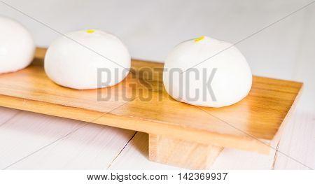 Chinese Bun dim sum on wooden tray