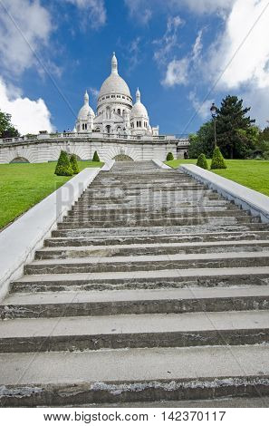 Sacre Coeur is a Roman Catholic church and minor basilica dedicated to the Sacred Heart of Jesus in Paris France. A popular landmark on Montmartre the highest point in the city.