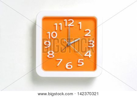 Orange Wall clock counting at 2 o clock