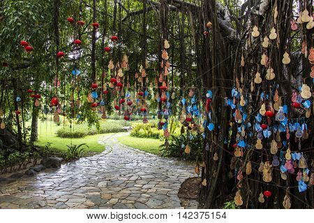 Wishing tablets on trees in a Tianya Haijiao (The end of the Earth) park, Hainan, China,