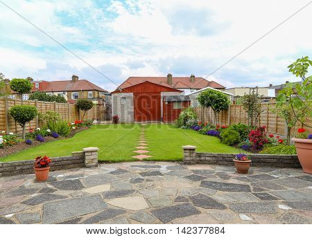 Typical London suburban garden of a semi-detached house