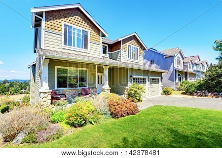 Curb Appeal Of Luxury Family House With Nice Landscape.