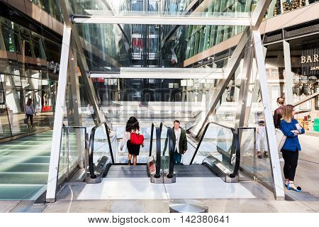 London UK - June 15 2016: One New Change mall with unidentified people. It is located near St Pauls Cathedral and is the only large shopping centre in the City of London designed by Jean Nouvel