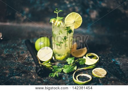 Mojito Cocktail With Lemon And Limes Garnish. Alcoholic Drink At Bar With Vintage Effect