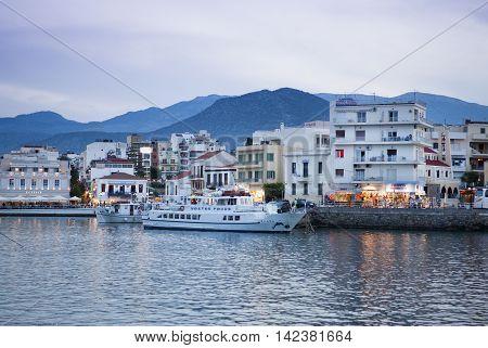 AGIOS NIKOLAOS, GREECE - MAY 2008: Sunset view - Old Town of Agios Nikolaos, Crete island, Greece, May 2008