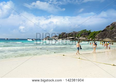 SIMILAN ISLAND, PHANG-NGA, THAILAND - JANUARY 13, 2013: Tourists on the beautiful beach of Mu Ko Similan National Park, January 13, 2013, Similan island, Phang-nga, Thailand