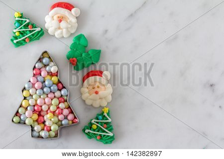 Christmas Baking Decorations for Cookies with Cookie Cutter Full of Sugar Pearls from Above with Copy Space