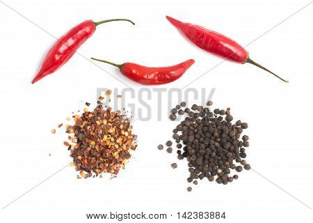 Black pepper and Calabrian pepper. Dry pepper in white background