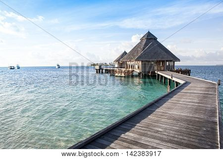 Wooden water bungalows on the tropical beach, Maldives