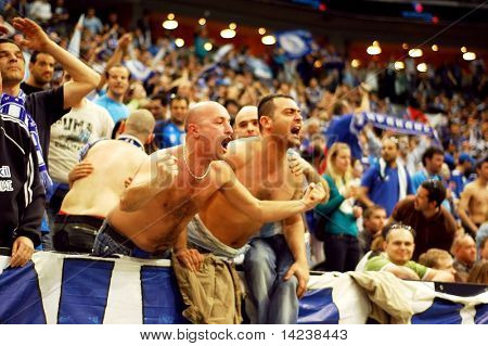 PRAGUE, CZECH REPUBLIC - APRIL 5: Iraklis team supporters watch the volleyball game of Final Four CEV Indesit Champions League at O2 Arena on April 5, 2009 in Prague, Czech Republic.