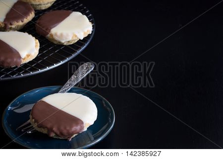 Neenish Tarts on Rack and Plate on Dark Background with Copy Space Horizontal