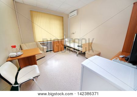 RUSSIA, MOSCOW - AUG 31, 2015: comfortable hospital ward with single bed, tables, television set, conditioner and fridge in multidisciplinary Clinic Center Endosurgery and Lithotripsy (CELT)