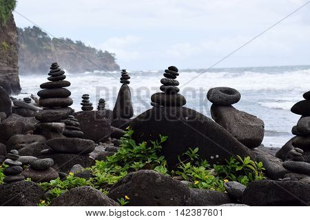 rock stacks balancing on the Polulu black sand beach, Kohala coast, Big Island, Hawaii