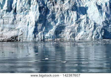 Packed blue ice of Margerie glacier shinning in the sun , Glacier Bay, Alaska