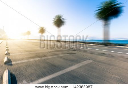 empty road with parking lot near water with cityscape and skyline of san francisco in sunny day