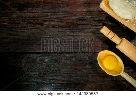 Dough, Rolling Pin And Egg