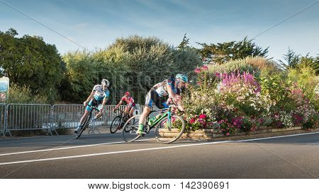 Professional Cyclist In A Corner At Full Speed