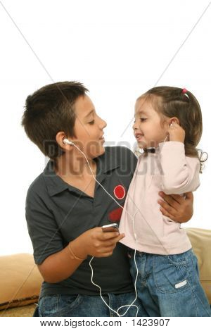 Children Enjoying A Mp4 Player Together