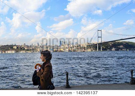 Istanbul Turkey - March 10 2013: View of the European side of Istanbul from the Bosphorus. The Bosphorus Bridge (Turkish: Bogazici Koprusu) also called the First Bosphorus Bridge (Turkish: 1. Bogazici Koprusu) or First Bridge (Turkish: Birinci Kopru) is o