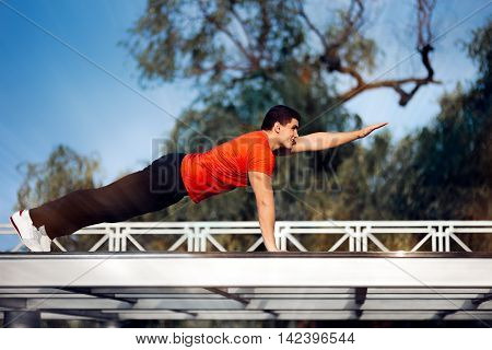 Athletic Man in Push-up Plank Position Training