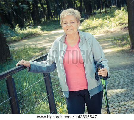 Vintage Photo, Elderly Senior Woman Practicing Nordic Walking, Sporty Lifestyles