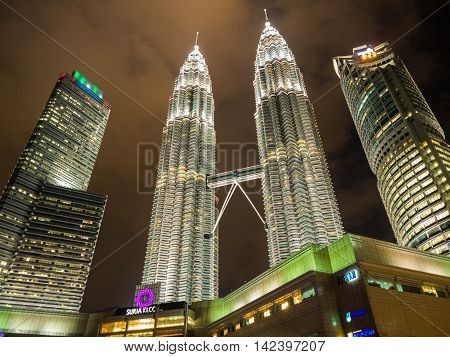 KUALA LUMPUR MALAYSIA - FEB 29: Petronas Twin Towers the famous landmark of Malaysia at night on February 29 2016 in Kuala Lumpur Malaysia. Petronas Twin Towers are twin skyscrapers and were the tallest buildings in the world during 1998-2004.
