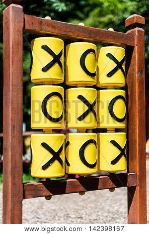 Tic-tac-toe game on the playground in sunny weather