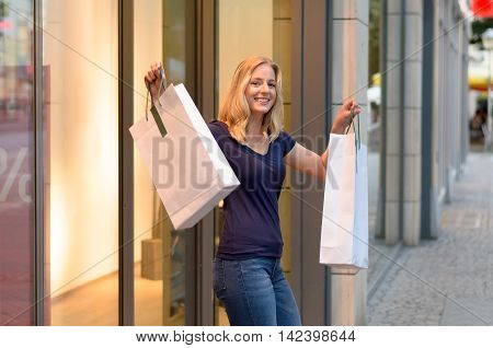 Happy Triumphant Young Women Shopper