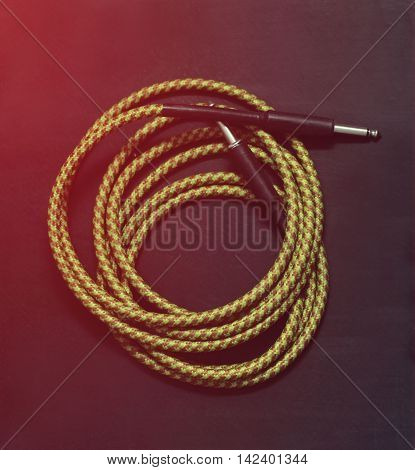 vintage guitar cable yellow isolated on black