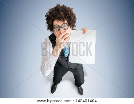Top View On Disappointed Businessman Showing White Empty Paper A