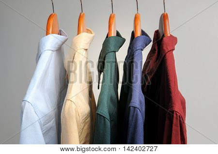 background of shirts hanging on a hanger.