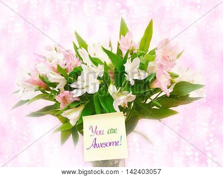 Bouquet of pink and white flowers on pink glitter bokeh background with word You are awesome