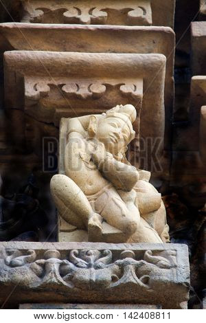 Charming elegantly posed stone sculpture at Chaturbhuj Temple Khajuraho Madhya Pradesh India Asia