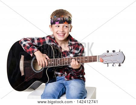 Boy Sitting And Playing On Guitar Isolated On  White Background
