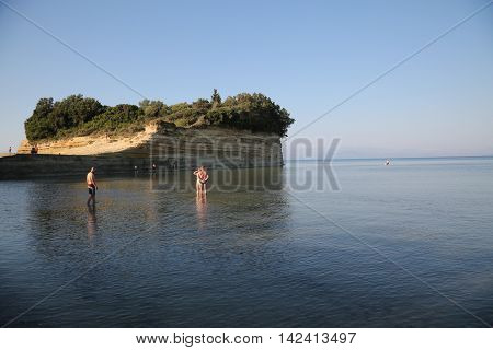 CORFU, GREECE - JULY, 23, 2016: Young people at Sidari beach