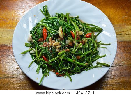 stir fried morning glory with garlic and chili on dish