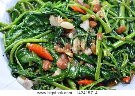 stir fried morning glory with soy bean paste on dish