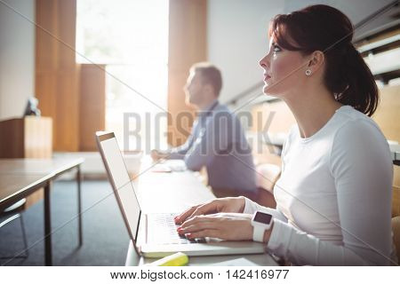 Mature student using laptop in the classroom