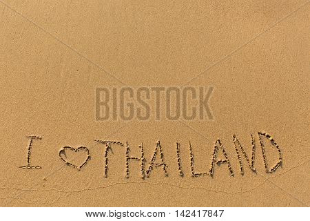I Love Thailand - manually written in the line of surf sea sand.