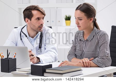 Patient and doctor talk about illness symptoms. Concept of good medical care and attention