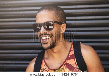 Cropped Shot Of Handsome Stylish African Man Wearing Trendy Sunglasses And Colorful Hipster Tank Top