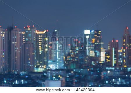 Blurred bokeh lights night view, city downtown, abstract background